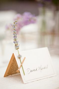 Place cards with a little wild flower attached :) Beautiful