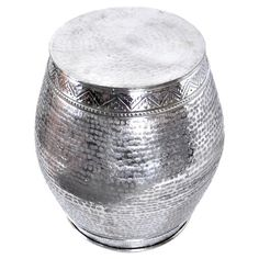 Hammered aluminum garden stool with a polished silver-hued finish.     Product: StoolConstruction Material: Alu...