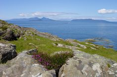 The Small Isles of the Inner Hebrides - the islands of Rum, Eigg and Muck -  from Ardnamurchan Lighthouse, Scotland, in June. [Photo by Jenny Chapman.]