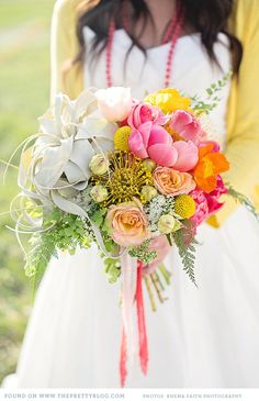 Colourful wedding bouquet of pincushion protea, air plant, peonies, craspedia and ferns | Photography: @Rhéma Peterson