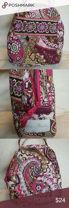 Vera Bradley Lunch Bag Fabric Vera Bradley Lunch Bag in the Very Berry Paisley pattern. I've never used it but somehow it still has markings from storage. Slight snag and discoloration on 3rd pic where the tag window is. Slight mark inside shown in 5th pic. Yellow transfer on the bottom from tissue paper it was stored with (seen on 4th pic) it's the biggest stain on the bag but not noticeable when in use. I haven't tried cleaning it so it all might be removable. Vera Bradley Bags
