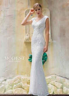Style TR11842 from Modest Bridal by Mon Cheri is an allover sequin lace modest sheath wedding dress that has cap sleeves, front and back V necklines, sequin lace designs that accentuate the natural waistline and curve of the hips, and a sweep train.