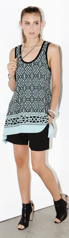 Diamond-patterned jacquard textures the flowy handkerchief fit of this Karen Kane tank.