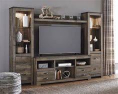 Trinell Brown Entertainment Center | Entertainment Furniture | The Classy Home | Best Deal Furniture