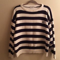 """Givenchy Genuine Vintage Oversize Nautical Sweater In phenomenal condition!! Has only ever been dry cleaned & no piling, fading, etc. No size/material tag but I would guess it could fit an 8-14, maybe 16 depending on how big you want it. I'm a 10 up top & still plenty room to spare. Probably cotton or a cotton blend. Dolman/batwing style. Waist lying flat across 20"""", pit to pit 24"""", length 24"""". I have TONS more high end & designer items to list so please check out rest of my stuff! The more…"""