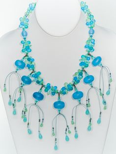 Two Son Jewelry - Light Aqua Resin Saucer Necklace, $127.00 (http://www.twosonjewelry.com/products/light-aqua-resin-saucer-necklace.html)