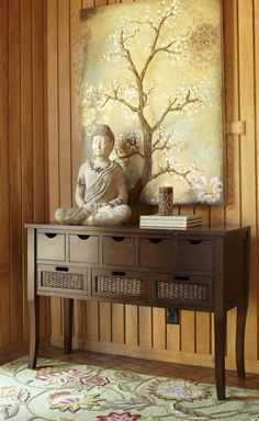 Bring peaceful energy into your main entry by combining a Buddha statue with a floral motif. See more feng shui decor tips at http://FengShui.About.com
