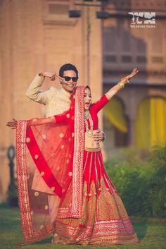 red bridal lehenga , crop top bridal lehenga , plain blouse , all over red lehenga , monotone red lehenga , red raw silk lehenga , gold bangles , bindas brides