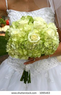 bride with white flowers in hands