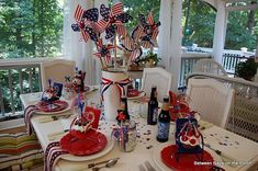 I love this table from Susan at BNOTP! The little chairs holding cupcakes are actually votive holders!! Sure wish I could find some of those!!