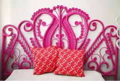 White wicker headboard upcycled to pink