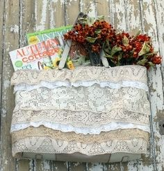 Pretty up an old or plain tote bag by adding layers of lace (can use up scraps for this project).  Tutorial.