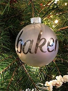 1. Get a clear ornament, stickers, spray paint and a stick 2. Take the silver cap off the clear ornament and place the stick inside 3. Place on the stickers (name, initial, picture etc...) 4. Spray paint it like crazy and let dry 5. Remove the stickers, place the silver cap back on and voila!