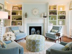 A soft but vibrant blue and green color scheme was the basis for the new transitional design. Comfy furniture and updated wood shelves anchor the room and give it a much cozier vibe.