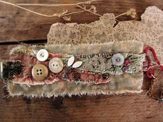 Salvage textile wrist cuff, vintage lace, button detail