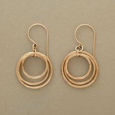 """CIRCLE OF THREE EARRINGS--In these three-circle hoop earrings, glimmering 14kt gold-filled rings go 'round and 'round in a trio of hoops that dance and sway harmoniously. Handmade in USA. Exclusive. 1-1/2""""L..polishingCloth {display:none"""