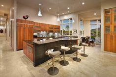 modern kitchen. I like the breakfast nook encased in windows.  Like the long counter.