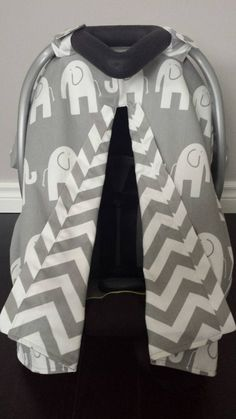 Infant car seat canopy to keep the sun out, the rain away and the cold outside. Made of 100% durable cotton, this canopy will also help keep all the well meaning people from touching your baby and spreading germs.  This canopy has a premium cotton grey chevron material on the inside, and a grey and white elephant exterior lining. Also has an opening with an easy snap slit, that let's you see your baby while driving, and keeps unwanted hands away. The back has a unique and beautiful pleat.