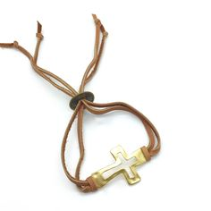 Faith and a Prayer is a Beautiful Adjustable Bracelet with an 18kGold Over Bronze Open Cross and Brown Deer Hide Leather. Adjustable Using a Small Bronze Asian Coin. Product #16-064