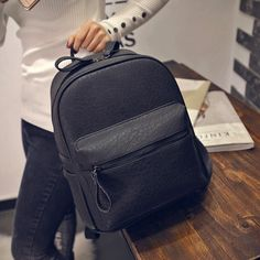 Item Type: Backpacks Size: 29cm x 25cm x13cm Rain Cover: No Closure Type: Zipper Pattern Type: Solid Lining Material: Polyester Capacity: Below 20 Litre