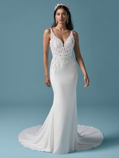 Sweet yet sophisticated? Simple yet alluring? Let's all make the case for gorgeous paradoxes with this sexy crepe sheath wedding gown in vintage-inspired lace.