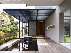 Zen Interior Details. House designed to focus on promoting social interactions showcasing a green oasis in the very heart of it.  Read more at http://freshome.com/2013/01/08/very-modern-segmented-house-promoting-social-interaction-in-singapore/#