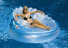 This jumbo water float is plush and luxurious. The Sofa features a bolster sofa back, cup holders, three pearl white throw pillows and a high-capacity re-chargeable air pump.Ahhhh can so see me floating around on this. Stock Pools, Giant Pool Floats, Pool Rafts, Water Floaties, My Pool, Pool Fun, Pool Lounge, Pool Accessories, Floating In Water