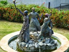 """Black History Notes  The Three Queens of Virgin Island  The bronze sculpture of the historic Three Queens has been placed in Blackbeard's Castle gardens.  """"Set in bronze, Queen Mary, Queen Agnes and Queen Josiah - who on Oct. 1, 1878, led laborers in setting fire to half of Frederiksted on St. Croix in a successful demand for better wages and working conditions.  """"The sculpture, made by famed Richard Hallier, shows the women standing with arms raised, holding a machete, jug of oil and…"""