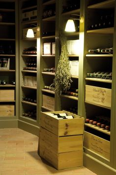 Green painted, brick floor wine cellar by Neptune Home