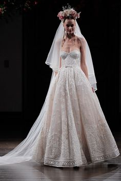 the ALMERIA by Naeem Khan. Stores in New York and Mass