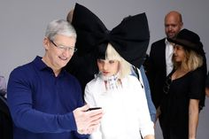 Apple CEO Tim Cook and dancer Maddie Ziegler are seen in the product demonstration area during a launch event on September 7, 2016 in San Francisco, California,