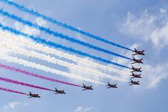 RAF Red Arrows in BAE Hawk T1 trainers Farnborough International Airshow Farnborough Airport Rushmoor Hampshire England  www.alamy.com/image-details-popup.asp?ARef=FC3222  #raf #red #team #jet #airplane #air #plane #display #aviation #airshow #force #hawk #arrows #flight #aerobatic #formation #sky #smoke #aircraft #royal #show #teamwork #military #flying #speed #fast #stunt #british #pilot #wing