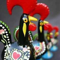 Set of four Cock of Barcelos figures from Portugal