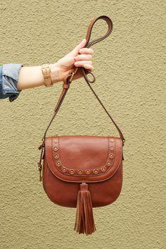Our weekend essential: the Emi crossbody tassel saddle bag.