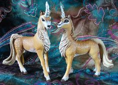 Two Forest Unicorns from the Schleich World of Bayala figures.