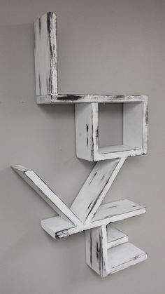 This is a beautiful white distressed love shelf that would look incredible as a…
