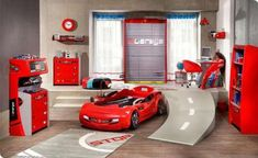 This little room is perfect for the little one who loves race cars. It has the cool race car bed in fire engine red, a street ramp, and even a quick fix station. follow me @ ★☆Danielle ✶ Beasy☆★