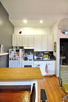 Jynne & Louie's Small & Colorful Brooklyn Duplex | Dark backsplash, white cabinets, grey wall