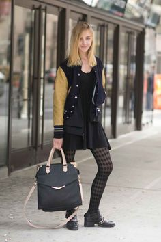 Rachel Darmody is studying communication design at Parsons and wears a vintage varsity jacket, an adidas blazer, Urban Outfitters bag, and Zara shoes.