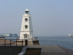 The Old wooden foreign- style lighthouse