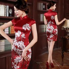 Floral silk red traditional Chinese mandarin collar wedding dress at Modern Qipao Chinese Clothing Traditional, Chinese Wedding Dress Traditional, Traditional Dresses, Ao Dai, Mandarin Dress, Mandarin Collar, Sexy Dresses, Fashion Dresses, Oriental Dress