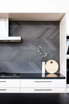 Splashback inspiration, grey long herringbone tiles - Found on Pinterest