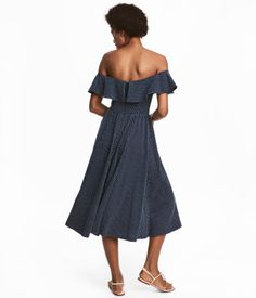 Dark blue/dotted. Calf-length, off-the-shoulder dress in thick, textured-knit cotton jersey. Wide elasticized ruffle at upper edge, seam at waist, concealed