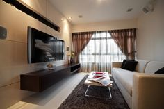 Living area with acrylic panels in a soft lily-white colour. Leather like laminate texture for our TV console.
