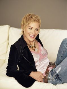 Sharon Stone - denim, satin cami & black jacket