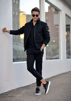 Adam Gallagher Wearing: Express black joggers, wool blend bomber jacket, cotton Henley & creative recreation Sneakers.: