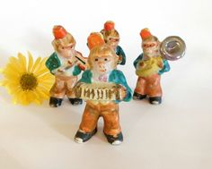 Size : 3 Tall Maker : Japan , red ink stamp on bottom of feet Model : Monkey in Fez Musical Band Condition: Very good Era : 1940/50 Material : Porcelain  All purchases will ship USPS First Class, in a small box , securely wrapped in bubble wrap. Looking for hard to find , unique Vintage items? Check out my other shops:  PaperCherries for all things Classic , Kitsch , and Cool :  https://www.etsy.com/shop/papercherries  _________________________________________________...