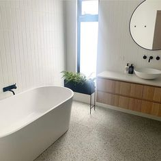 A beautiful light filled bathroom, using our Redfern terrazzo look tile in the mixed colour and the Riverton Matt White subway tiles in a… White Bathroom Tiles, Modern Farmhouse Bathroom, Bathroom Tile Designs, House Bathroom, White Subway Tile, White Subway Tile Bathroom, Bathroom Interior Design, White Subway Tiles, Terrazzo