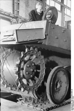 Assembling a Tiger hull at the factory. Tank is fitted with transport tracks. Probably a early model hull as it appears that it has a two mounted light system.