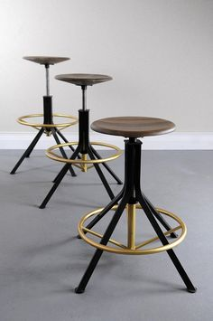 Three Architect's Stools at various heights by Studio DUNN with walnut seats and blackened steel bases with brass details
